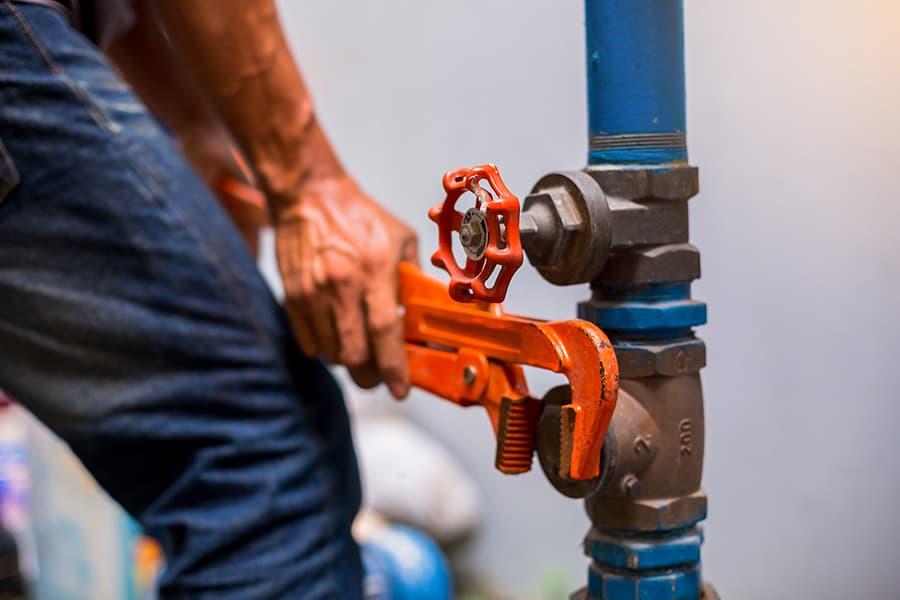 Plumber Drains Hot Water Tank